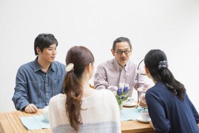 Asian family talking at table