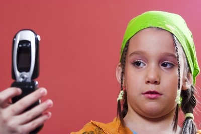 Young girl taking selfie with phone