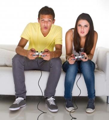 16 yo teen boy and girl playing video game