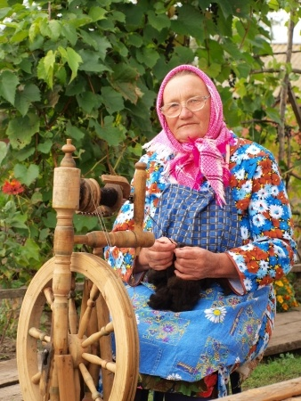 Old woman spinning yarn