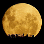Moon Rising over people outlined