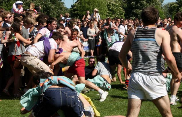 PIC BY GEOFF ROBINSON PHOTOGRAPHY 07976 880732.  ******NO BYLINE********  PIC SHOWS  THE organised FIGHT between the Caesarians, Jesus' inter-year drinking society and the Girton Green Giants,on Jesus Green Cambridge during Caesarian Sunday drinking party.   Passers-by were shocked to see more than 1000 drunken Cambridge University students STRIPPING OFF and VOMITING at a riotous summer term party in a PUBLIC park in the historic city centre.  Families enjoying the spring sunshine were disgusted to see rowdy students downing excessive amounts of alcohol, then THROWING UP and WEEING in the park flower beds at midday on a Sunday afternoon.  More than 1000 students attended yesterday's (May 1) annual party, known as Caesarian Sunday, which historically takes place on Jesus Green in Cambridge on the first bank holiday of the summer term.  Many of them were members of the college drinking societies and spent the day taking part in shocking and bizarre initiation ceremonies.  Girls were seen drinking port through condoms, while others wore kippers round their necks while they downed pints.  SEE COPY CATCHLINE Cam Uni students drunk party