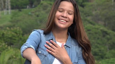 66845042 - teen girl with hand over heart